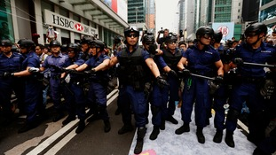 Police guard HSBC headquarters after clearing protests sites near the financial district.