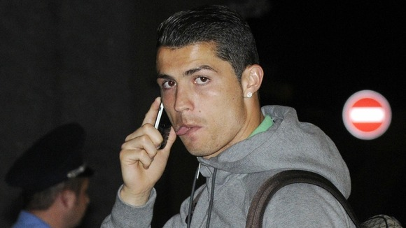 Portugal's Cristiano Ronaldo talks on his phone at the airport in Donetsk, Ukraine.