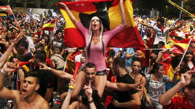 Spanish fans celebrate the victory over Portugal at the Fan Zone in Madrid, Spain.