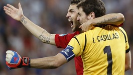 Spain's Cesc Fabregas celebrates with his teammate Iker Casillas after scoring the decisive penalty.
