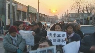 Protesters in Beijing after successfully breaking in to a 'black jail' to free inmates