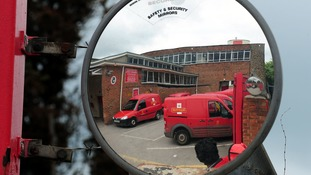General view of Royal Mail vans reflected in a mirror at Swdalincote Post Office, Derbyshire.