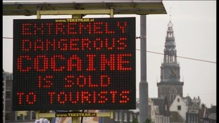A sign in Amsterdam warning tourists about drugs