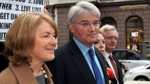 Former cabinet minister Andrew Mitchell MP arrived at the High Court in London with his wife Dr Sharon Bennett.