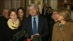 Andrew Mitchell was surrounded by his family and friends as he delivered his brief statement outside the High Court.