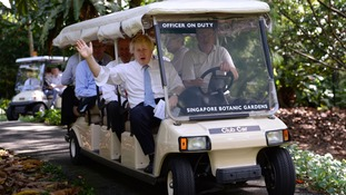 Boris Johnson is taken on a tour of the Singapore Botanic Gardens