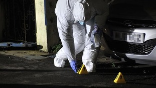 Forensic teams marking evidence