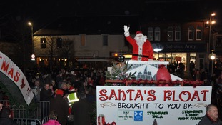 Santa arrives as crowds gathered to watch the Christmas lights being switched on at the Castle Square