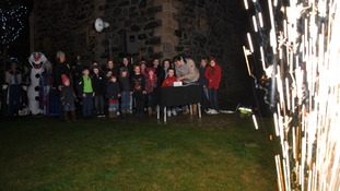 Children from Kirkcolm P School watch as fellow pupil Zack Ashton switches the lights on