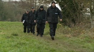 police officers searching the area by the River Tone at Nynehead
