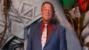 Stephen Fry arrives on the green carpet for the premiere of The Hobbit: Battle of the Five Armies, at the Odeon Leicester Square in central London.