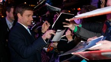 Martin Freeman signs autographs as he arrives on the green carpet for the premiere of The Hobbit: Battle of the Five Armies.