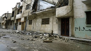 Damaged houses are seen in the Sunni Muslim district of Bab Amro in Homs in February of this year