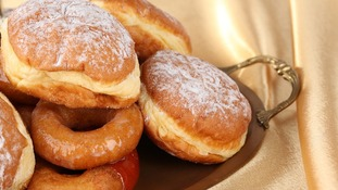 Foods commonly eaten on Chanukah include doughnuts.