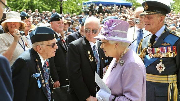 Queen Elizabeth II and the Duke of Edinburgh talk to Ed Carter-Edwards a former member of Bomber Command from Canada
