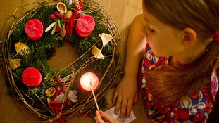Christians light first candle on Advent wreath to start countdown to Christmas.