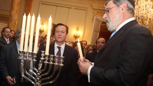 David Cameron celebrating Chanukah last year in London.