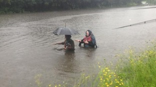 People trying to get home through the Newcastle floods