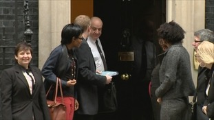 Cllr Nick Forbes hands the petition to Number 10 Downing Street