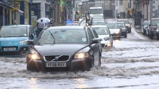 Drivers struggle through flood water in Kendal