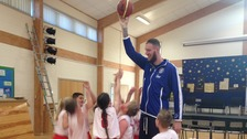 "Paul ""Tiny"" Sturgess towering above the school children at Saughall Primary School in Chester."