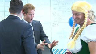 Prince Harry jokes with a trader in fancy dress as he took to the trading floor at ICAP's annual charity day