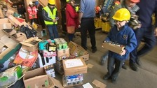 Volunteers collect goods which will soon be shipped to Sierra Leone.