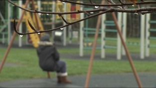 Blurred woman on swing