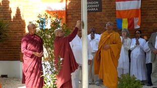 Traditional raising of the Buddhist flag at the London Buddhist Vihara.