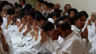 Many devotees wear white clothing for the traditional ceremonies.