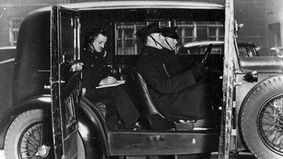 Officers in an early wireless car, receiving a Morse Code message from the Information Room.
