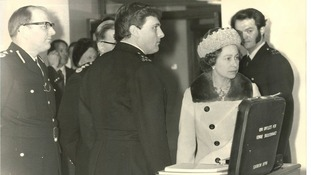 PC Michael Teague (right) meeting Queen Elizabeth II during her visit to New Scotland Yard.