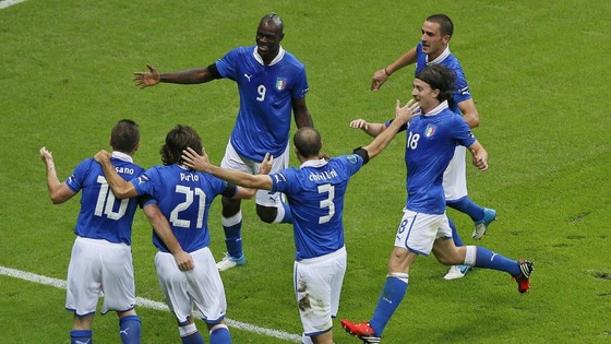 Italy&#x27;s Mario Balotelli, top left, is celebrated by teammates after scoring the opening goal during the Euro 2012  Semi Final 