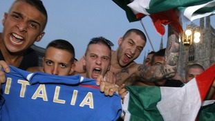Italian supporters celebrate their team's victory