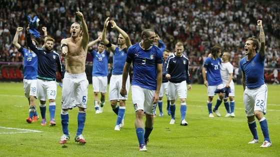 Italian team mates celebrate their shock victory over the German side