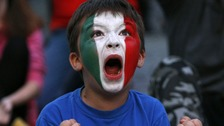 A young Italy soccer fan celebrates during the Euro 2012 semi-final match between Germany and Italy