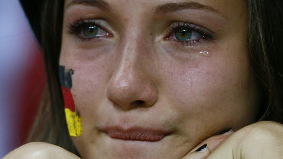 A woman cries as she her German side lose in the Euro 2012 semi-final to Italy 