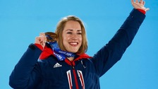 Lizzy Yarnold at the medal ceremony for the women's skeleton event at the 2014 Sochi Winter Olympics