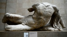 This headless statue of a river god, seen here in London in October, is now in a Russian museum.