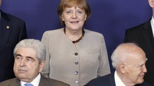 Cyprus' President Demetris Christofias and Greece's President Karolos Papoulias and Angela Merkel