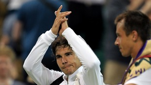 Nadal waves goodbye to the Wimbledon crowd.