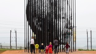 Community members paid their respects at a memorial at the site of Mandela's arrest in Howick.