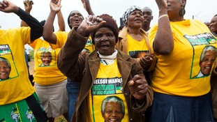 African National Congress supporters donned Mandela t-shirts to pay tribute to his struggle against white-minority rule.