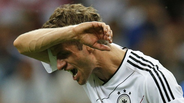Germany's Thomas Muller reacts during the semi-final in Warsaw.