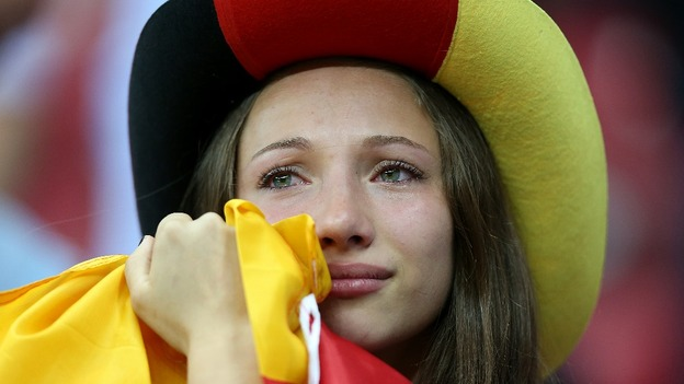 A German fan looks dejected in the stands after the game.