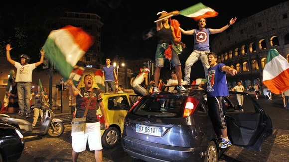 Italian fans celebrate the win in front of Rome's ancient Colosseum.