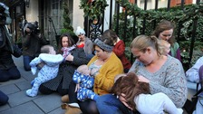 Free to Feed campaigners breastfeed their children outside Claridge's hotel, in Mayfair, London