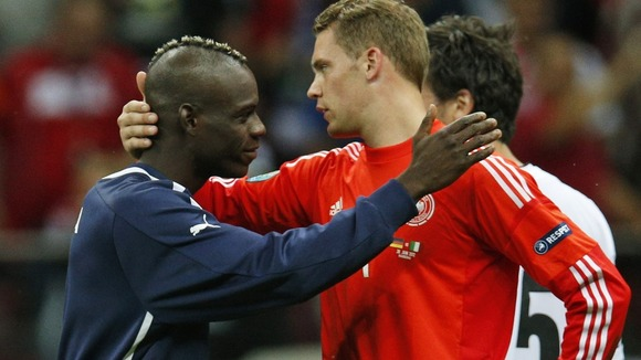 Germany goalkeeper Manuel Neuer is comforted by Italy's Mario Balotelli in Warsaw.