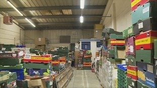 piles of food crates in a warehouse