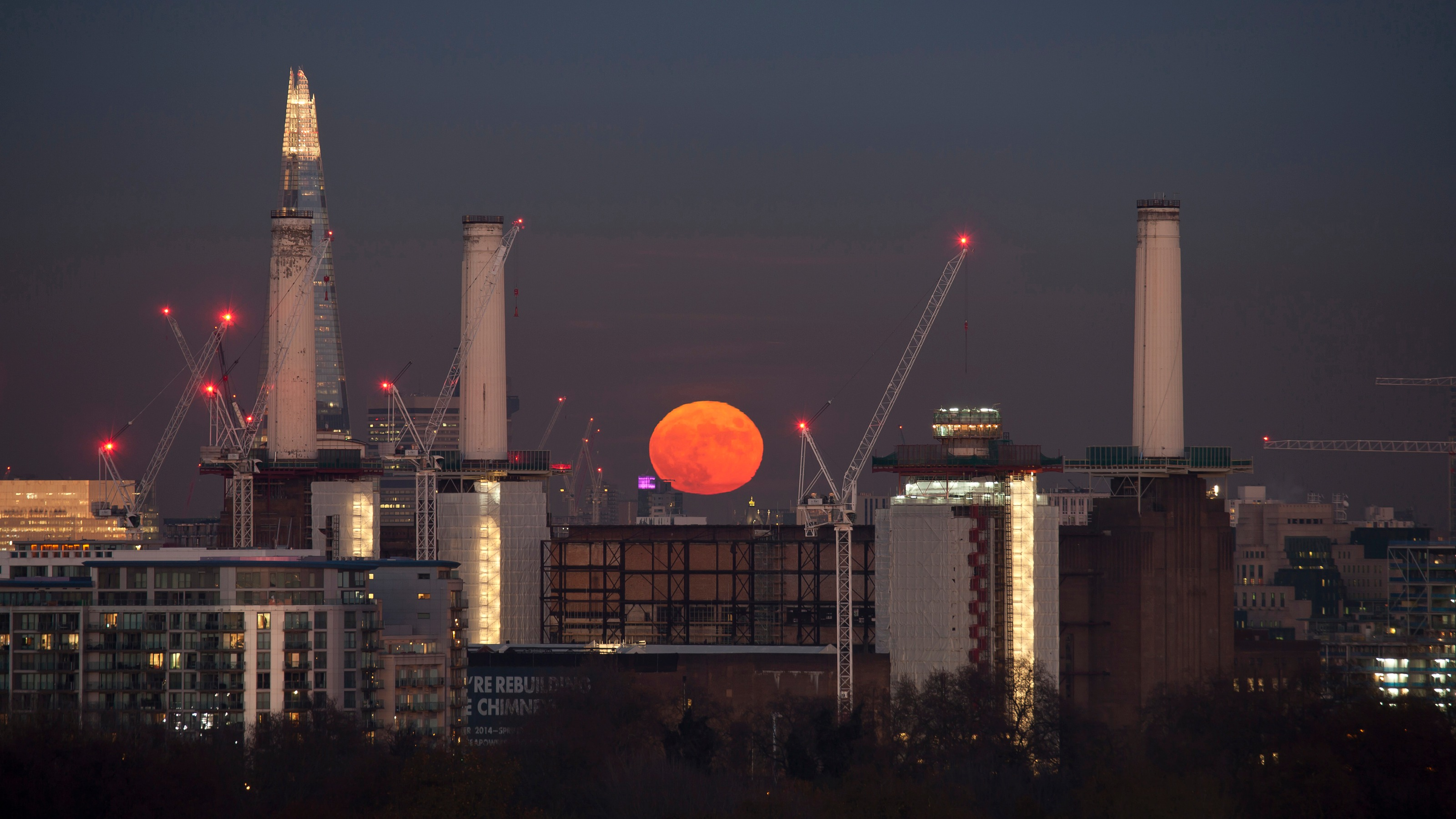 A stunning look at London from the capital's rooftops, including a blood red full moon